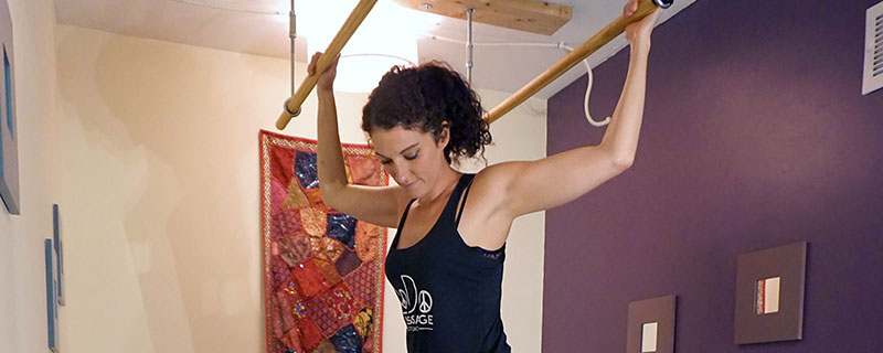 In Ashiatsu Massage, our therpists hold on to wooden bars on the ceiling  and use body weight to apply smooth gliding strokes with deep pressure.